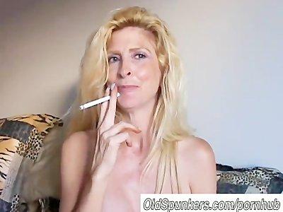 Beautiful blonde MILF enjoys a smoke break