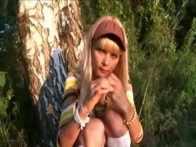 blond chick 18yo Loly playing outside